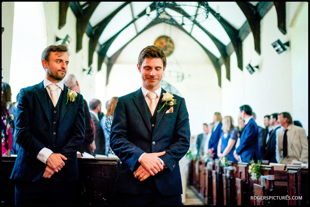Groom waits nervously during a church wedding