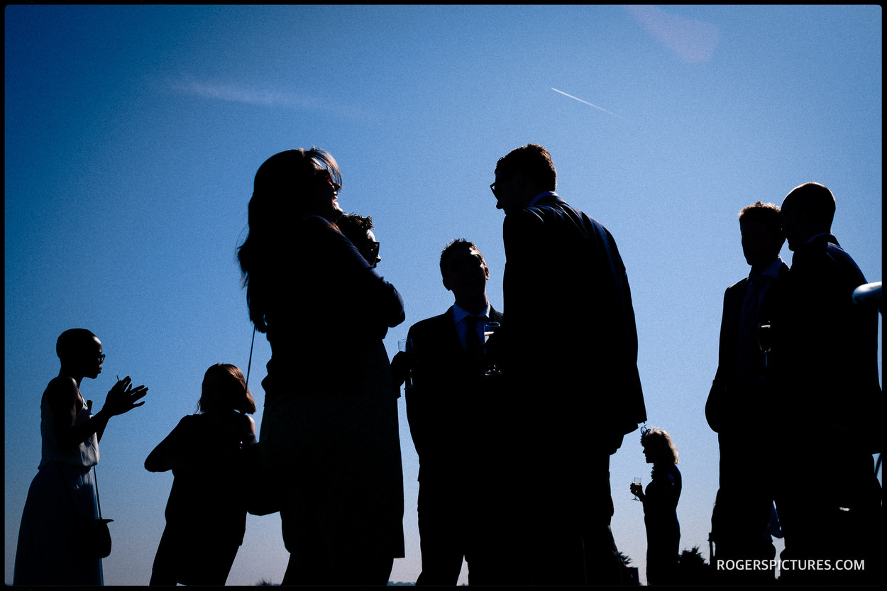 Silhouettes of wedding guests at Thorpness Country Club