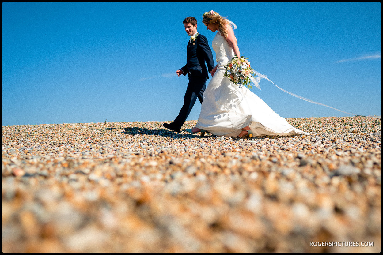 Bride and groom portraits on the beach at Thorpness