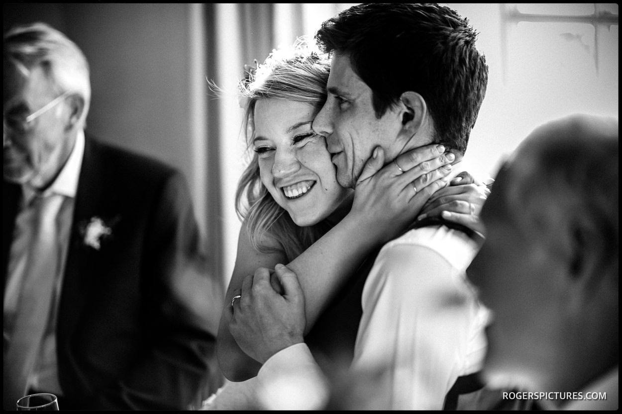 Bride embraces at Thorpness Country Club wedding