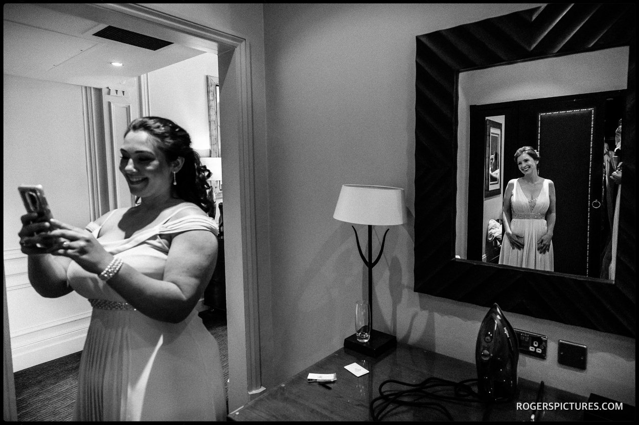Black and white picture of bride getting ready at Nutfield Priory Hotel