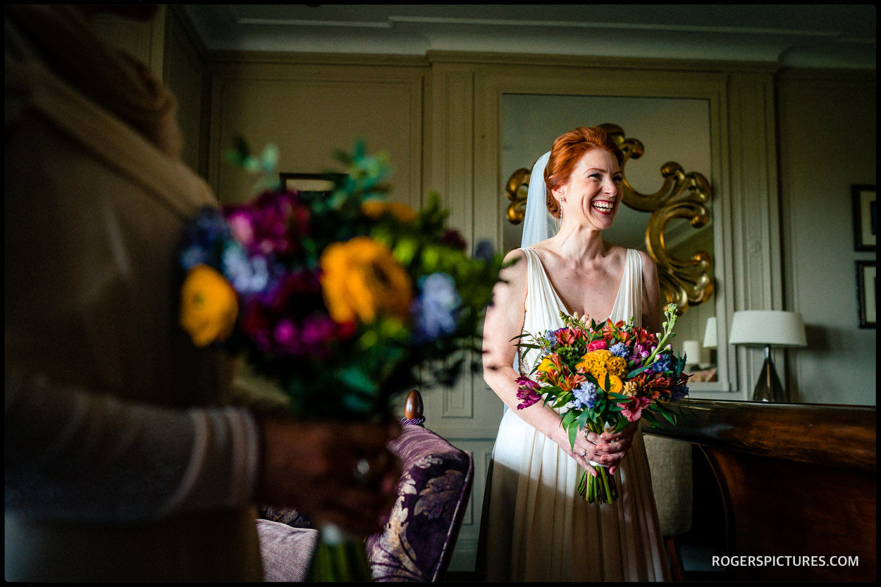 Bride and colourful bouquets at Nutfield Priory Hotel