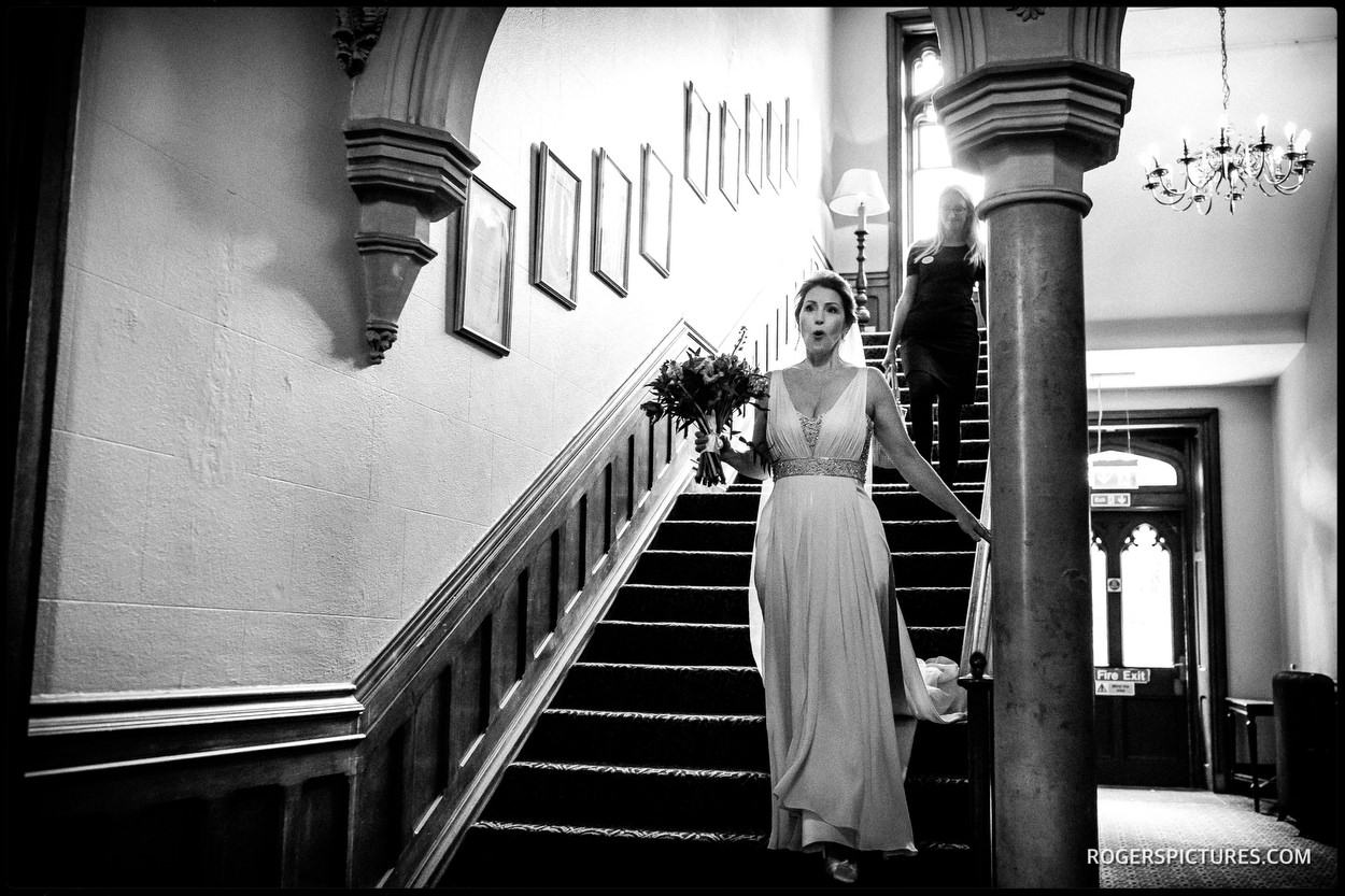 Bride on the stairway at Nutfield Priory Hotel