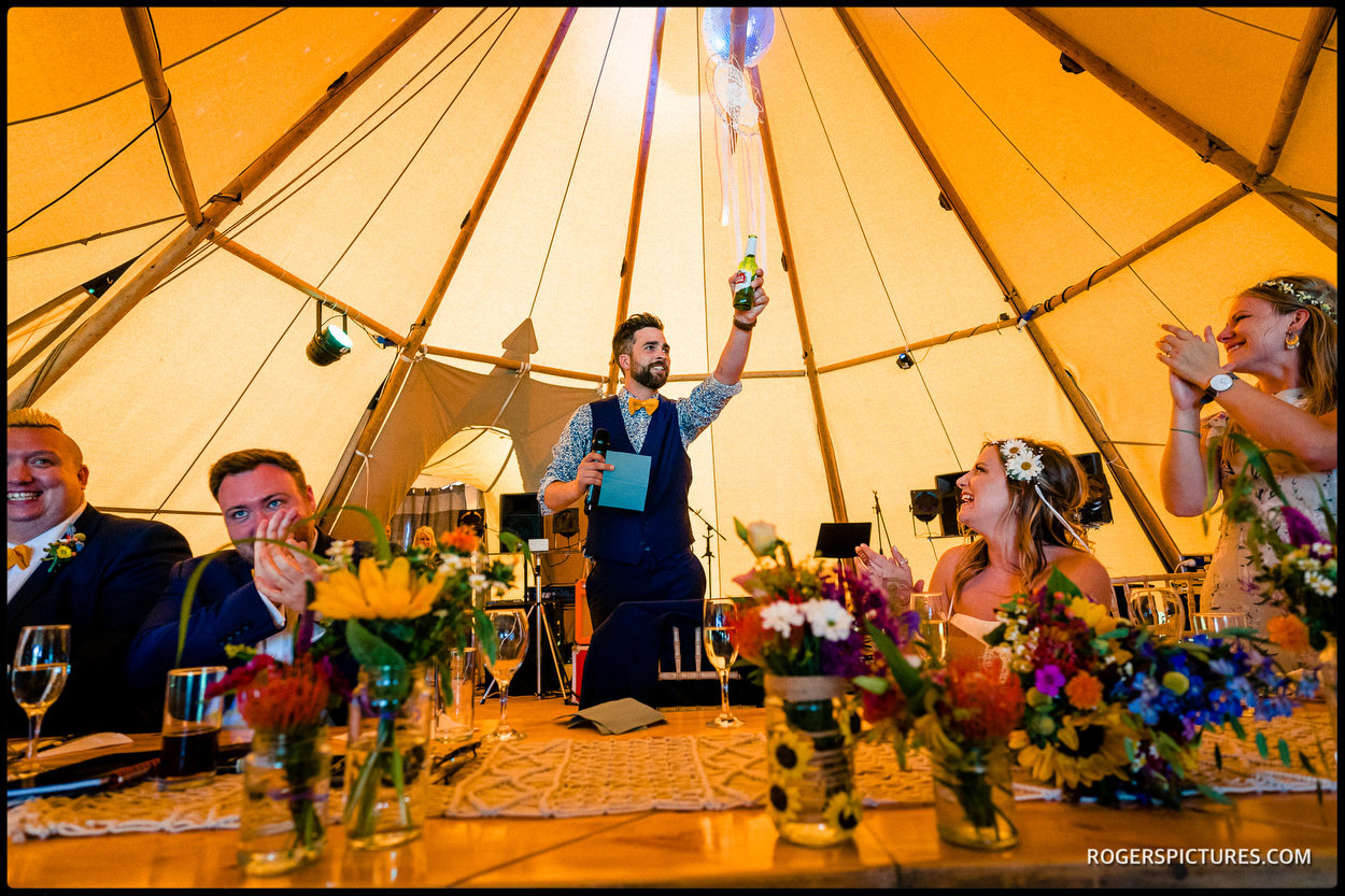 Groom a a Tipi wedding