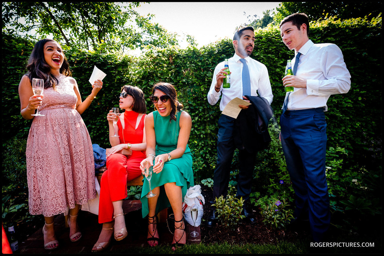 Wedding guests enjoy a garden reception in Oxfordshire