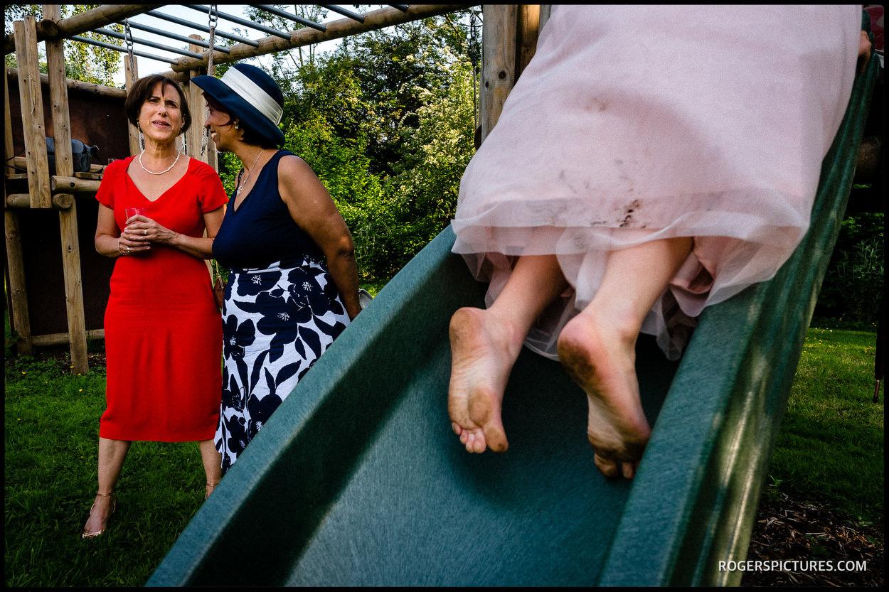 Playful girl on a slide at a wedding reception