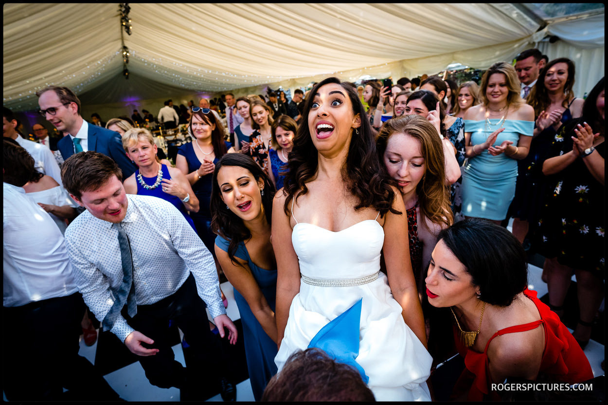 Bride at jewish chair dancing