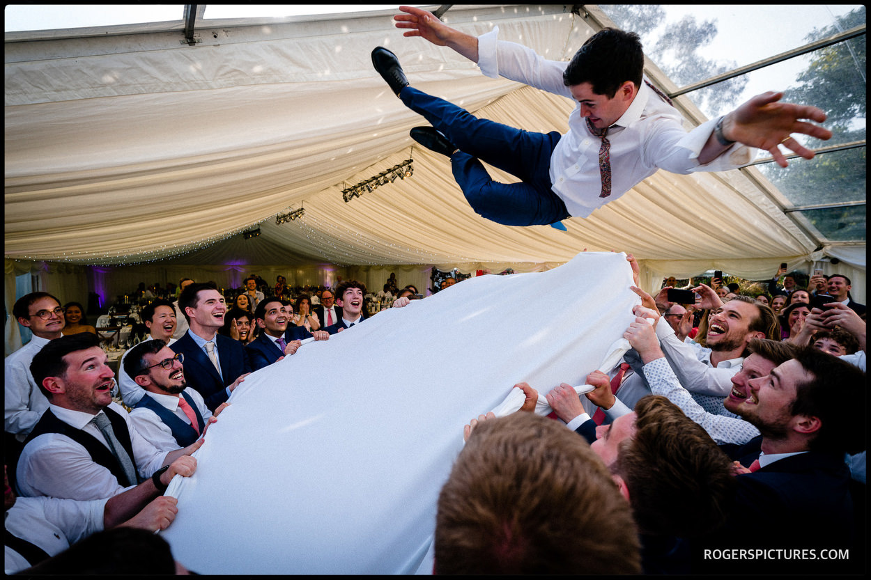 Flying groom during jewish wedding