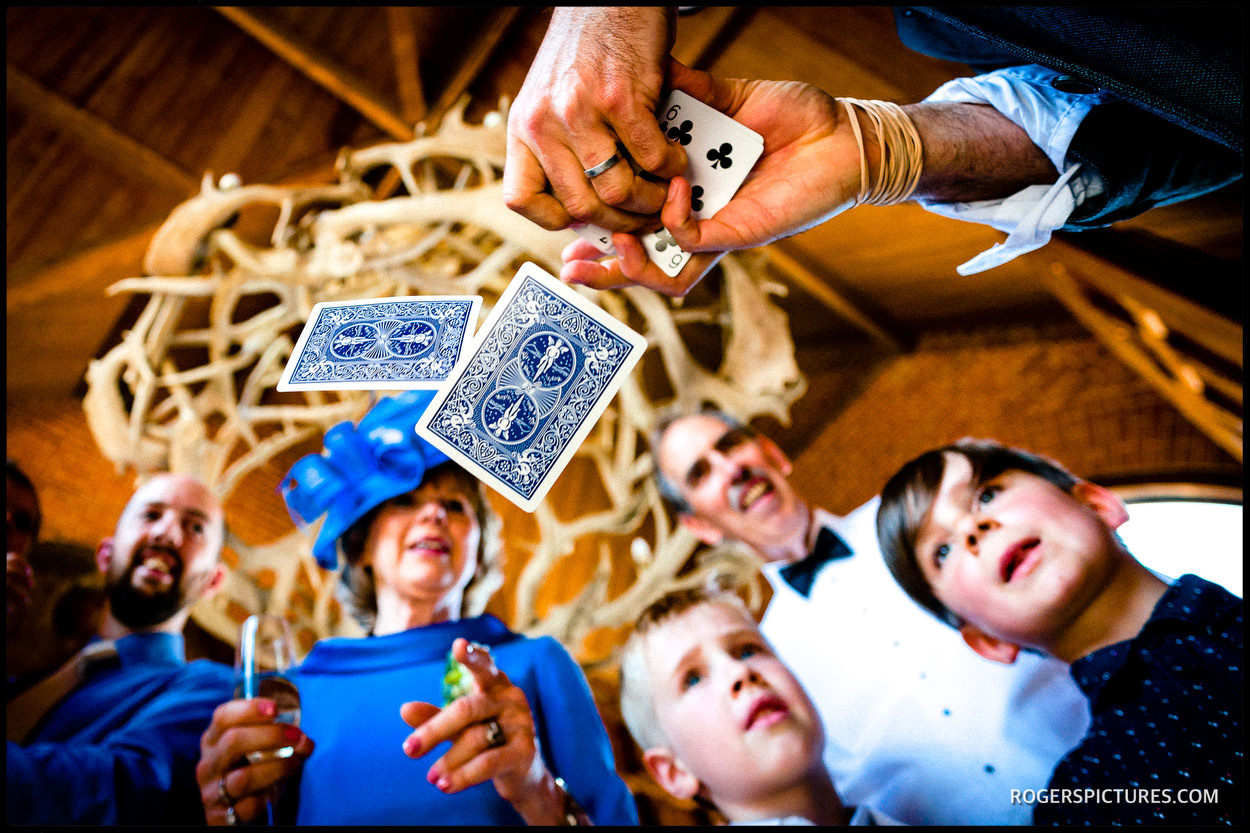 Magician card trick at Waddesdon wedding