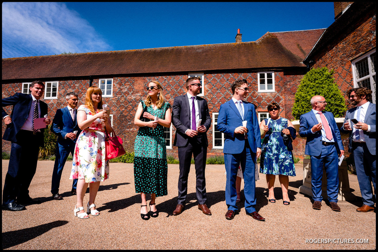 Guests in the sun at a London wedding