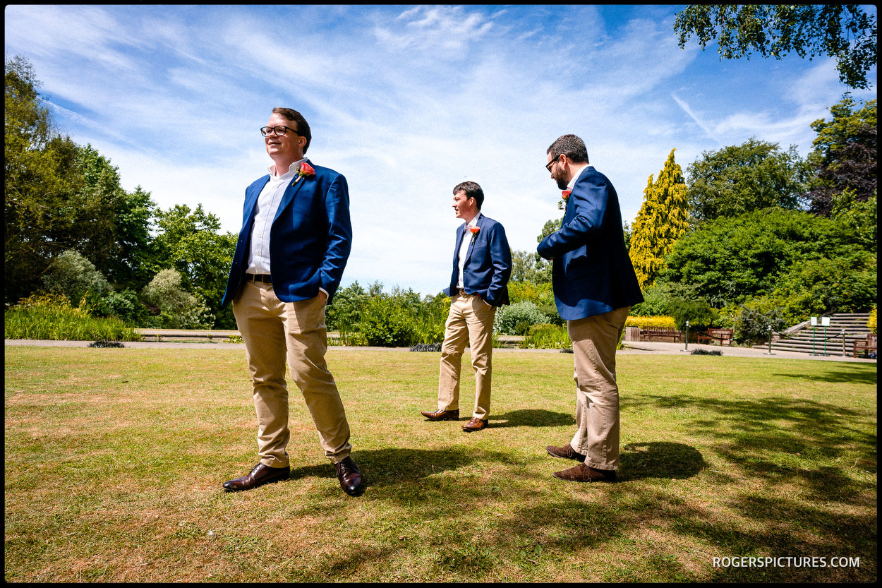 Groomsmen wait at The Hill Garden in Hampstead