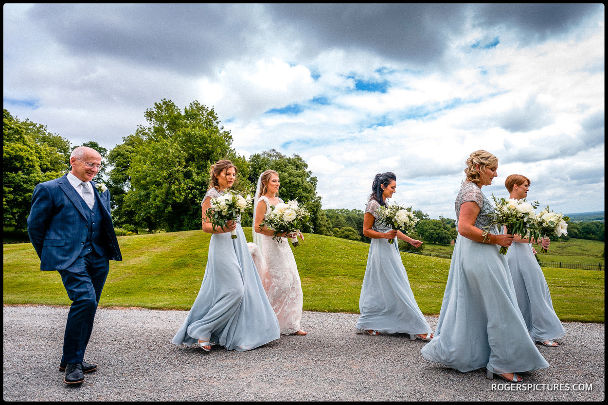 Bridesmaids escort the bride to church in Kent
