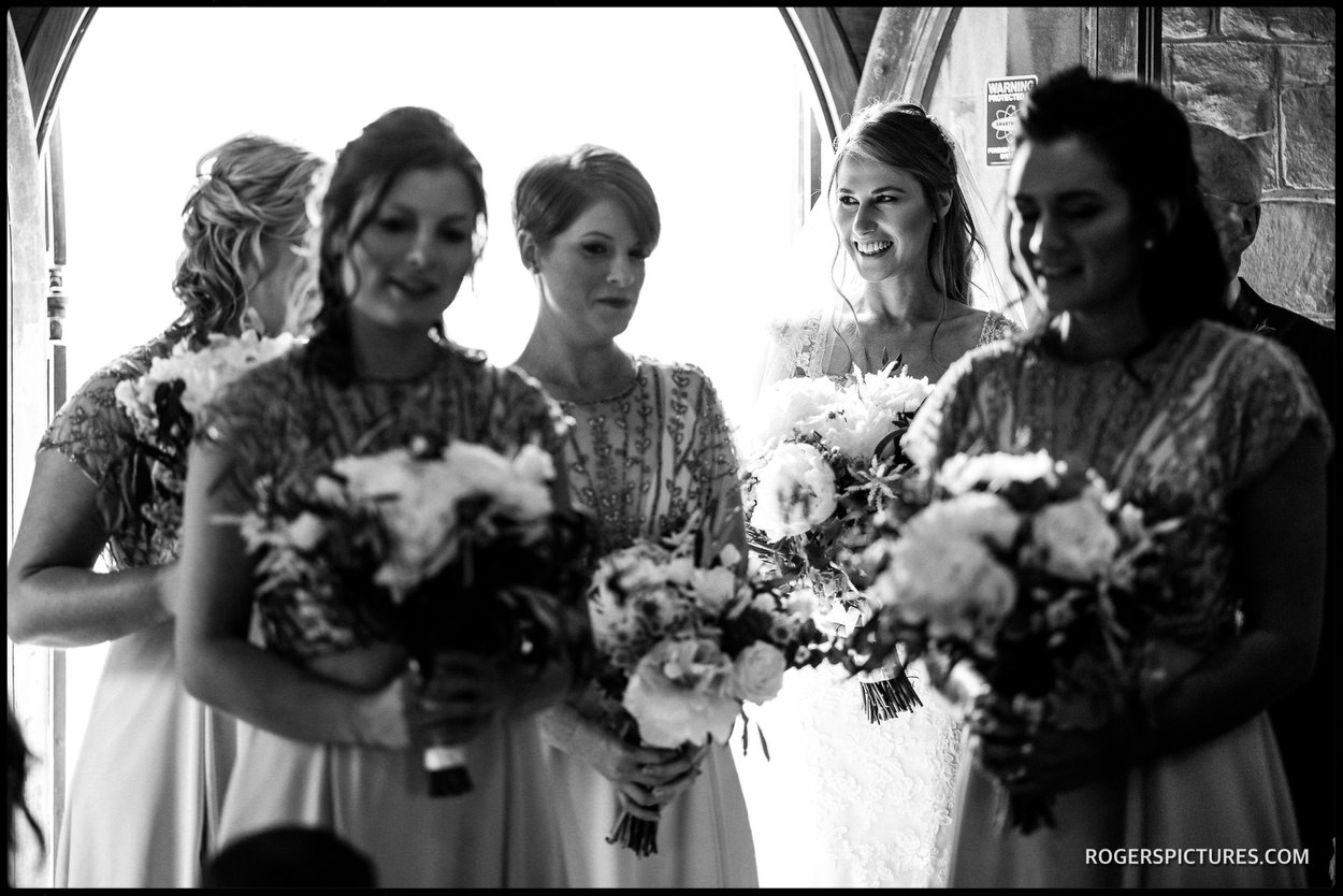 Black and white wedding photograph in the church doorway