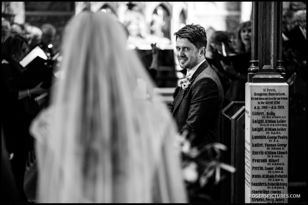 Grooms first look at bride in church