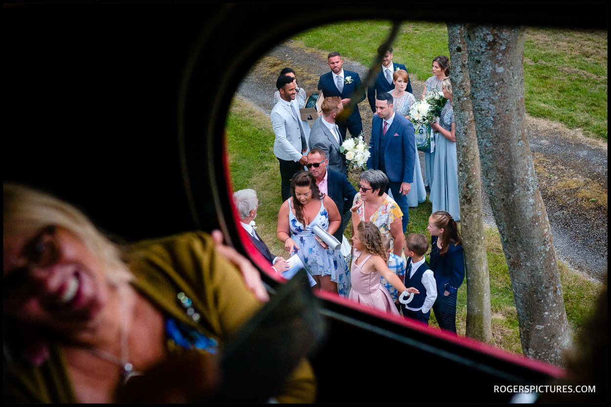 Wedding guests board a bus for Leeds Castle