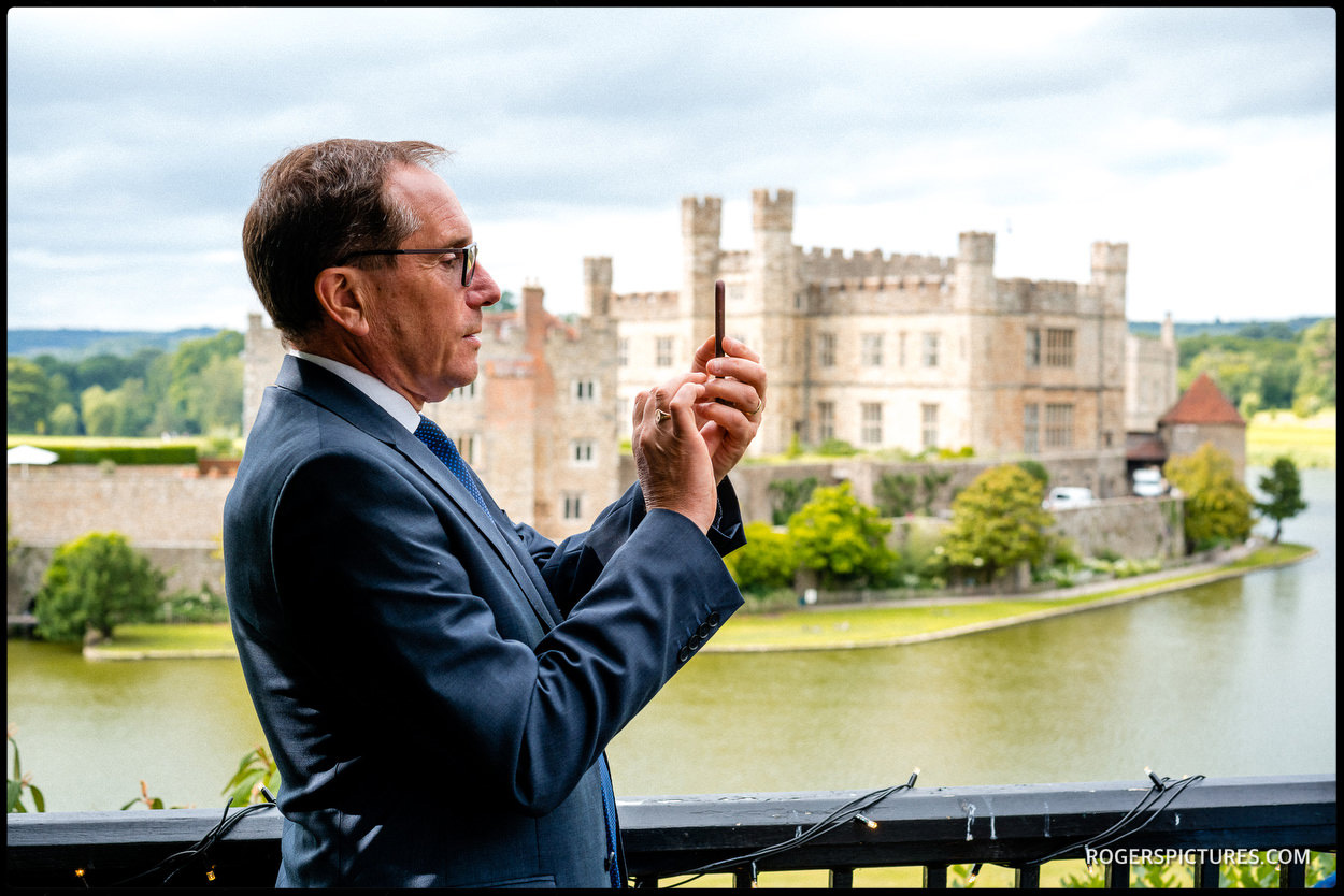 Guest taking a picture at Leeds Castle wedding