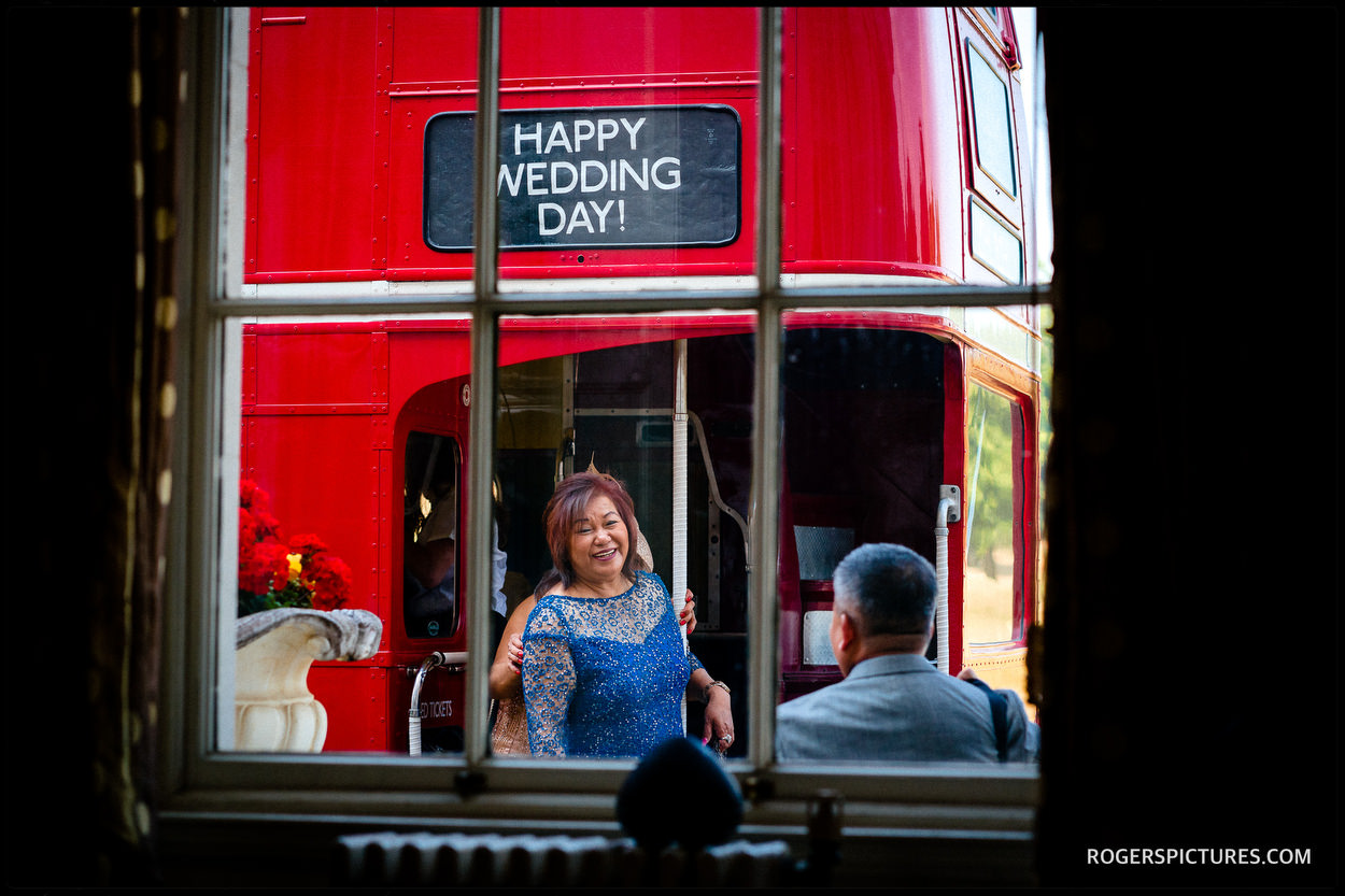 Double decker wedding bus outside Addington Palace