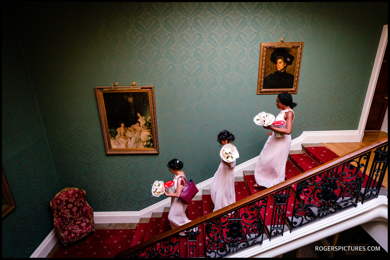 Bridesmaids on the stairs at Addington Palace
