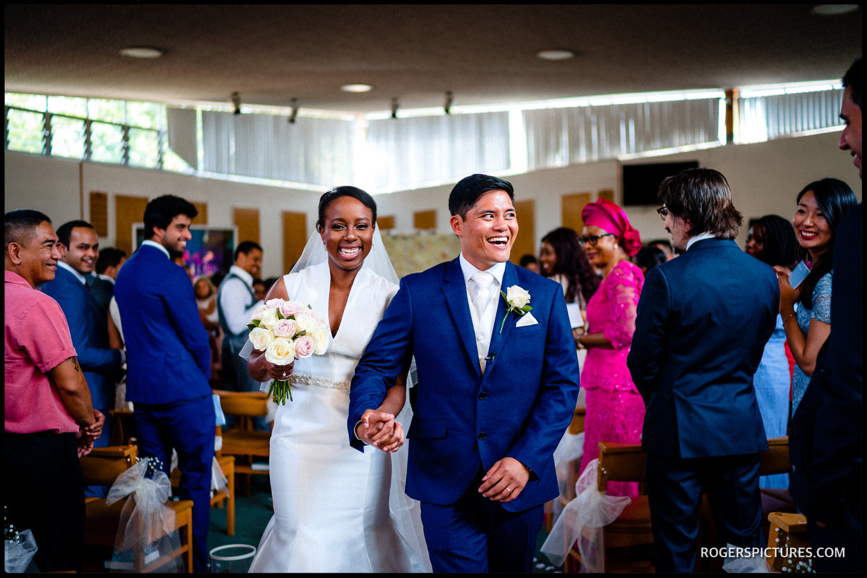 Newly wed couple recessional at church