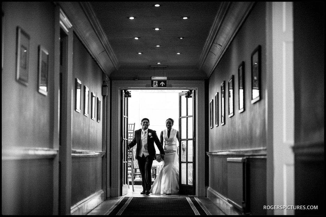 Documentary wedding picture of bride and groom's entrance