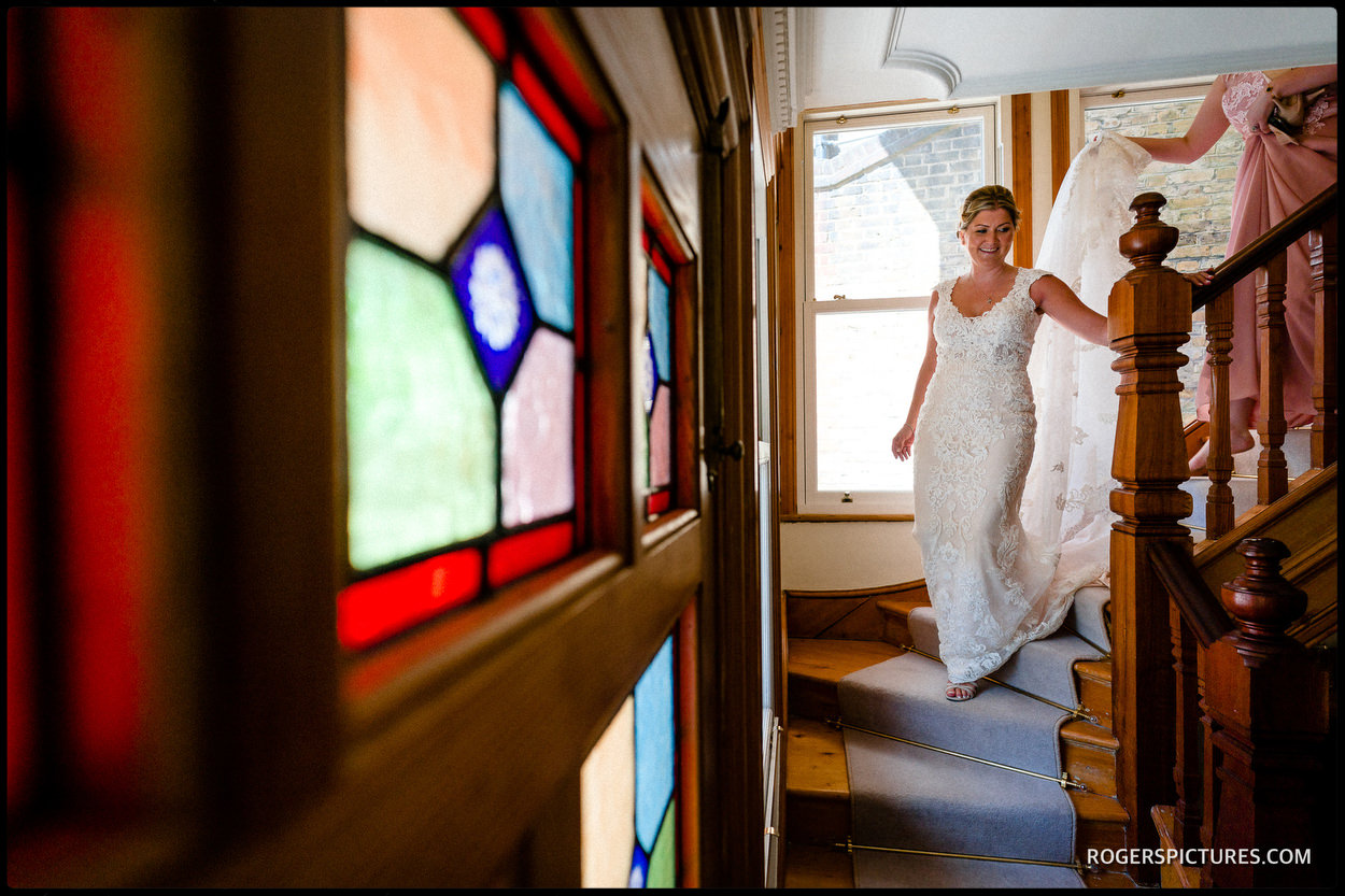 Bride in her wedding dress on stairs
