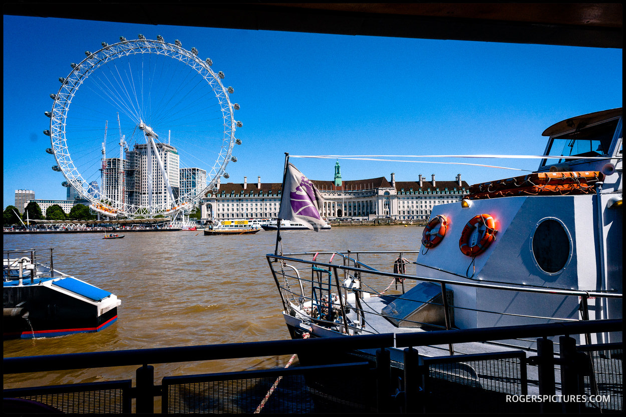 Thames boat and London Eye
