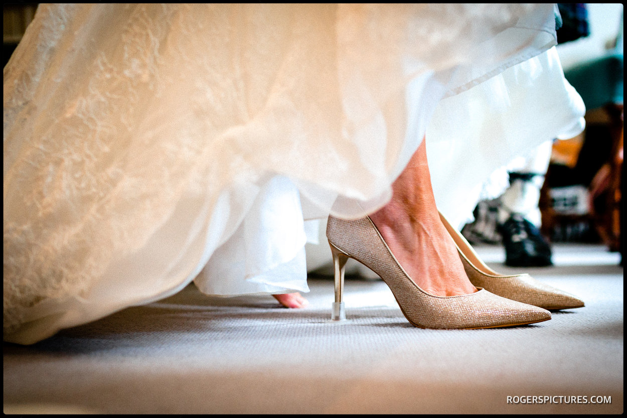 Bride in her wedding shoes at Hatfield
