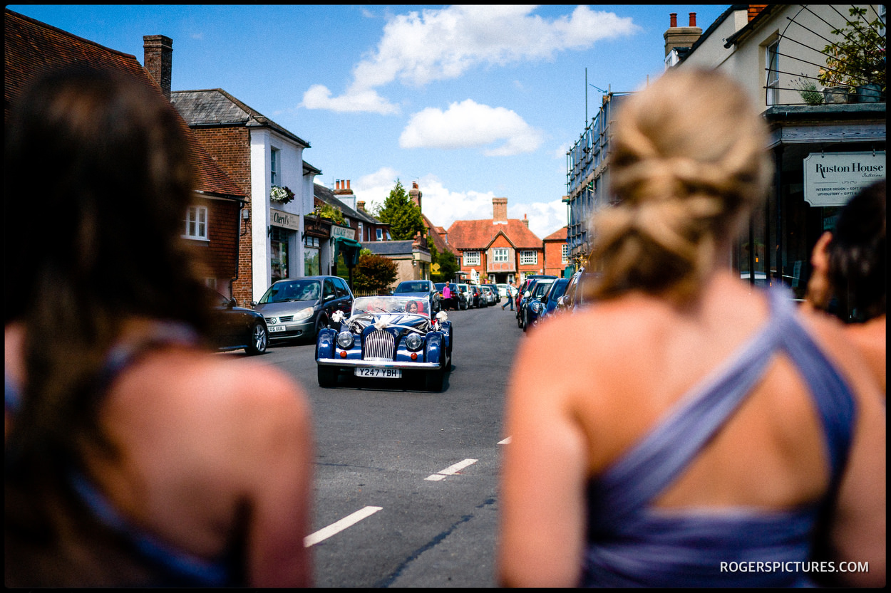 Bride arrives in a Morgan