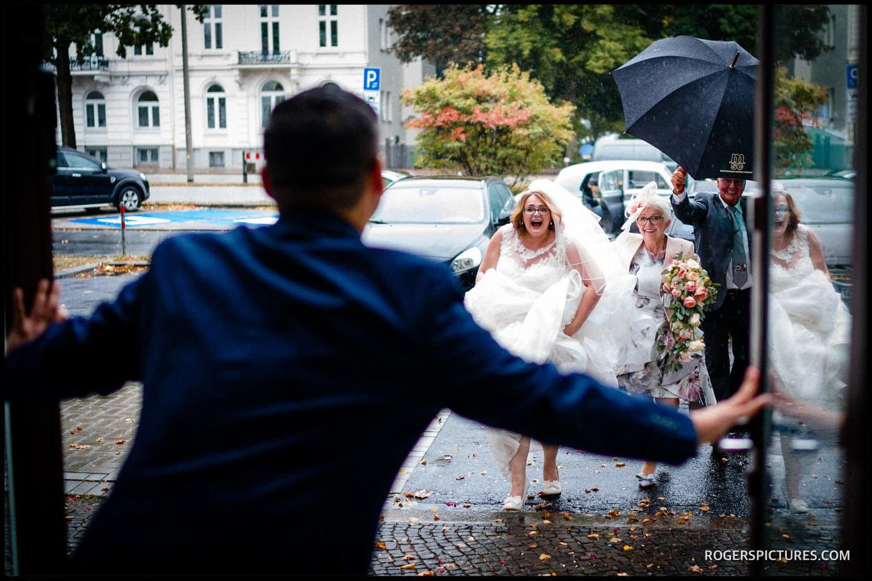 Wet weather wedding arrival in Germany