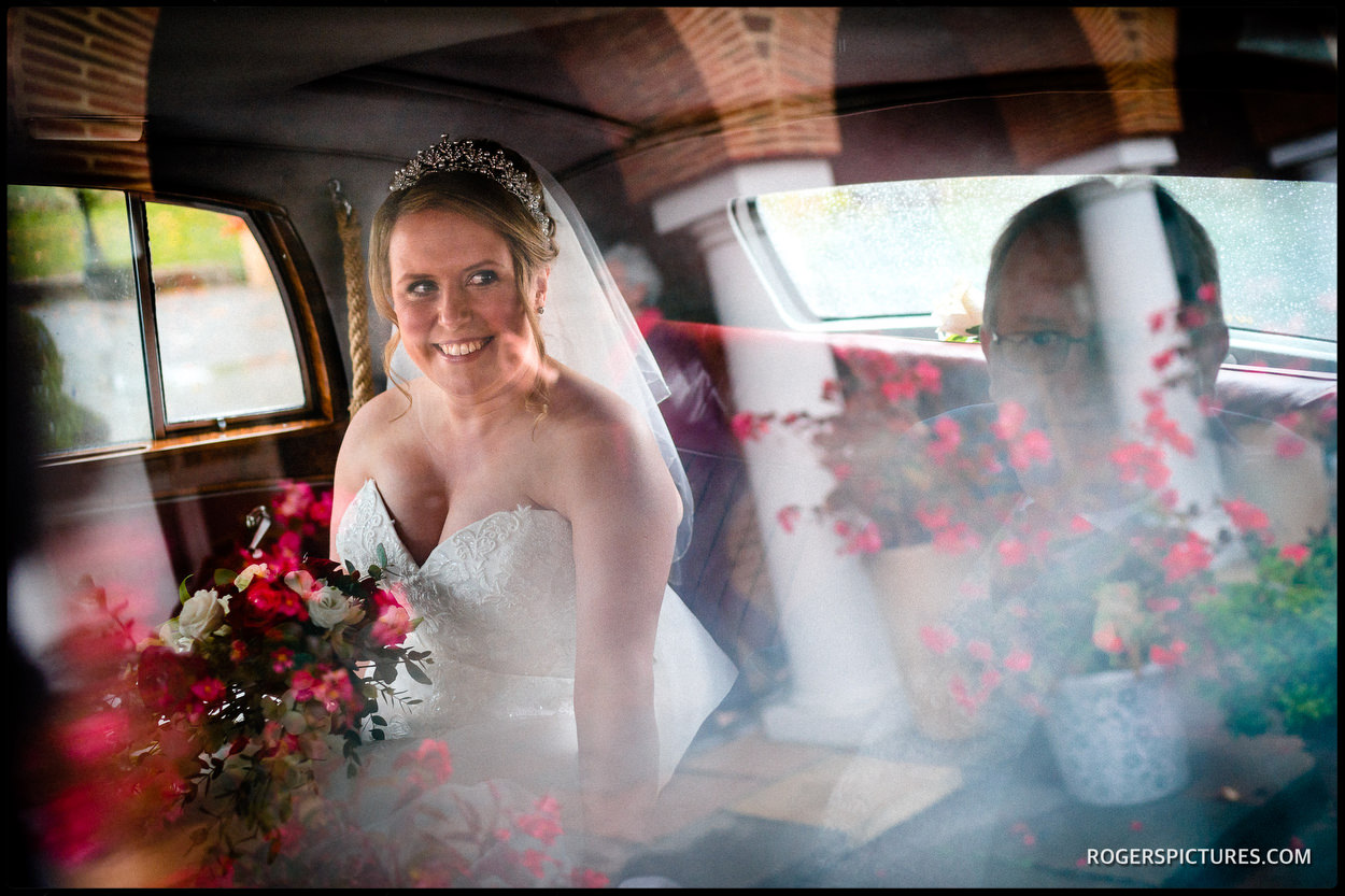 Bride in wedding car at St Anthony's RC Church in Slough