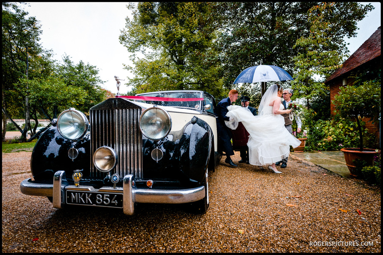 Wet wedding at Stoke Place Hotel in Buckinghamshire