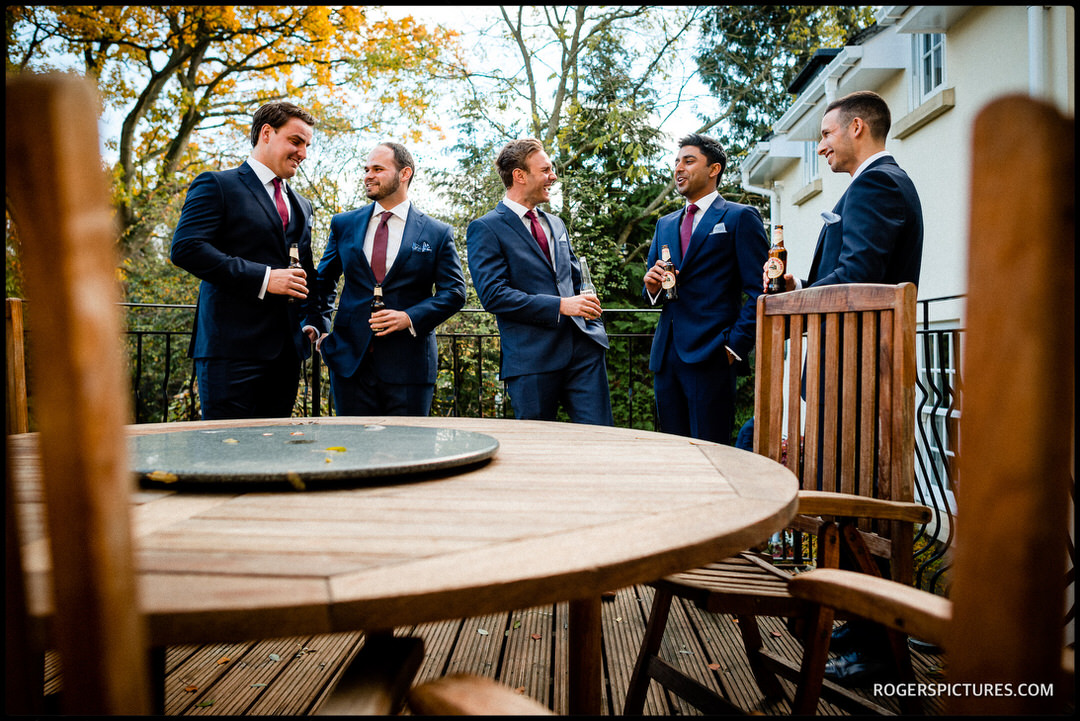 Groom and groomsmen enjoy a beer before the ceremony
