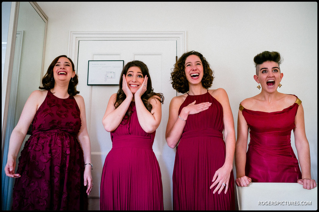 Bridesmaids react to seeing bride in wedding dress