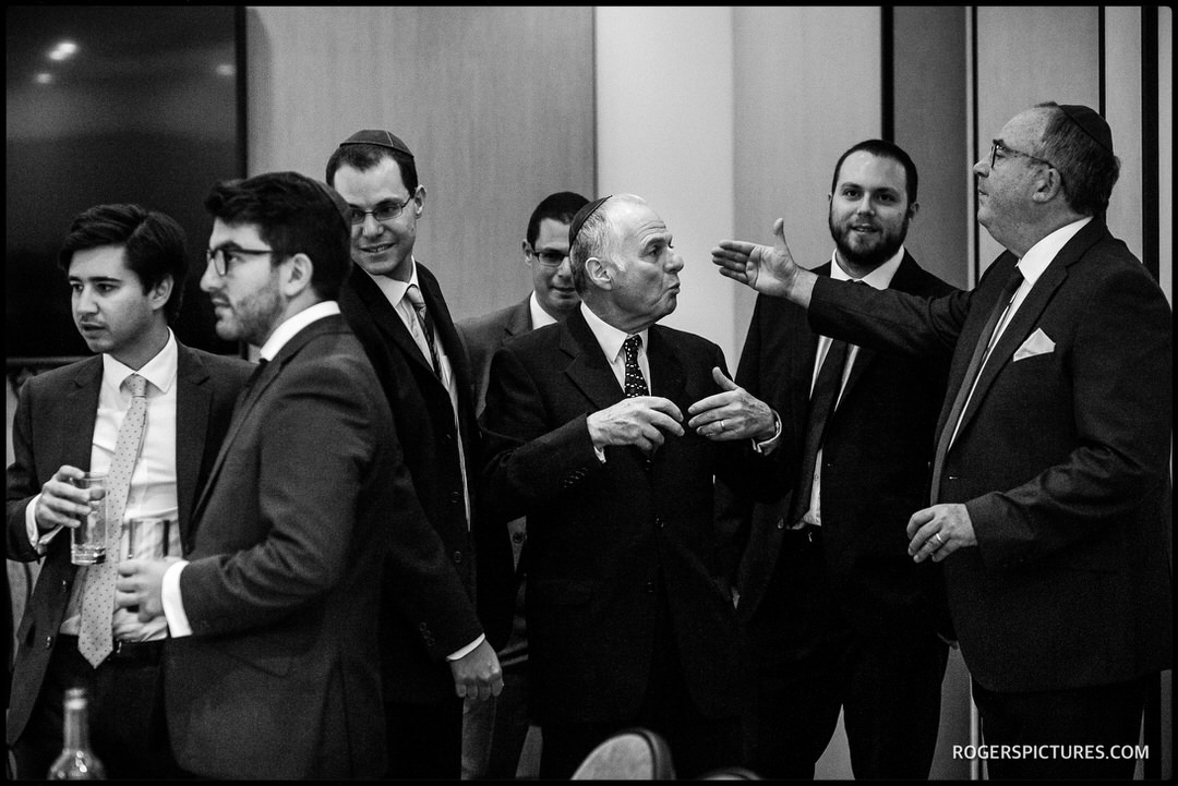 Documentary photo of the Tish at a Jewish wedding in Herts
