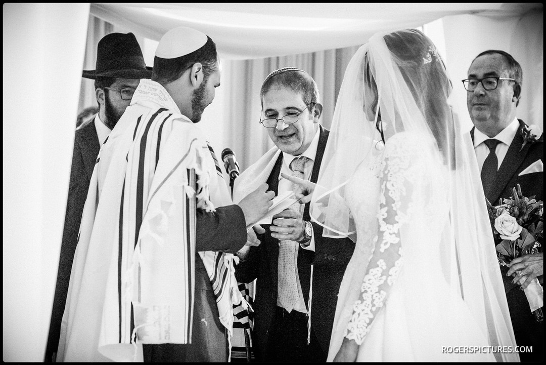Rabbi conducts a wedding ceremony at The Grove in Watford, Hertfordshire