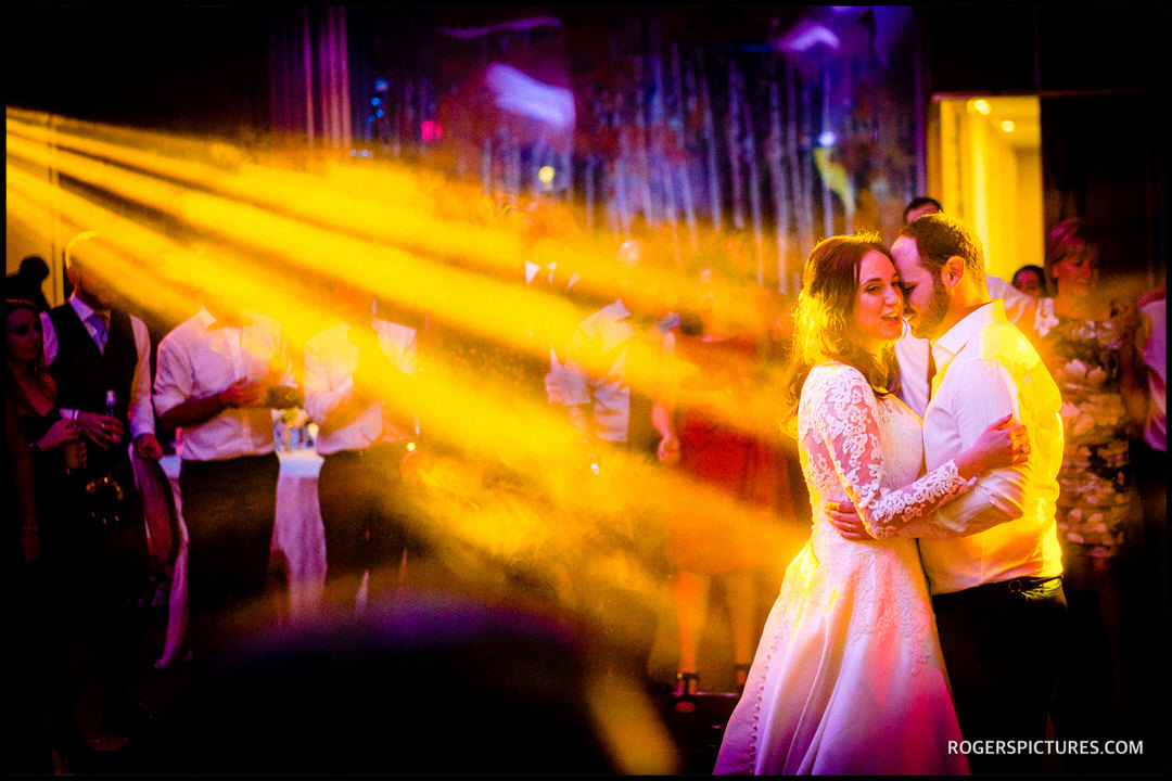 Beautiful lighting on the bride and groom during a wedding dance at The Grove hotel