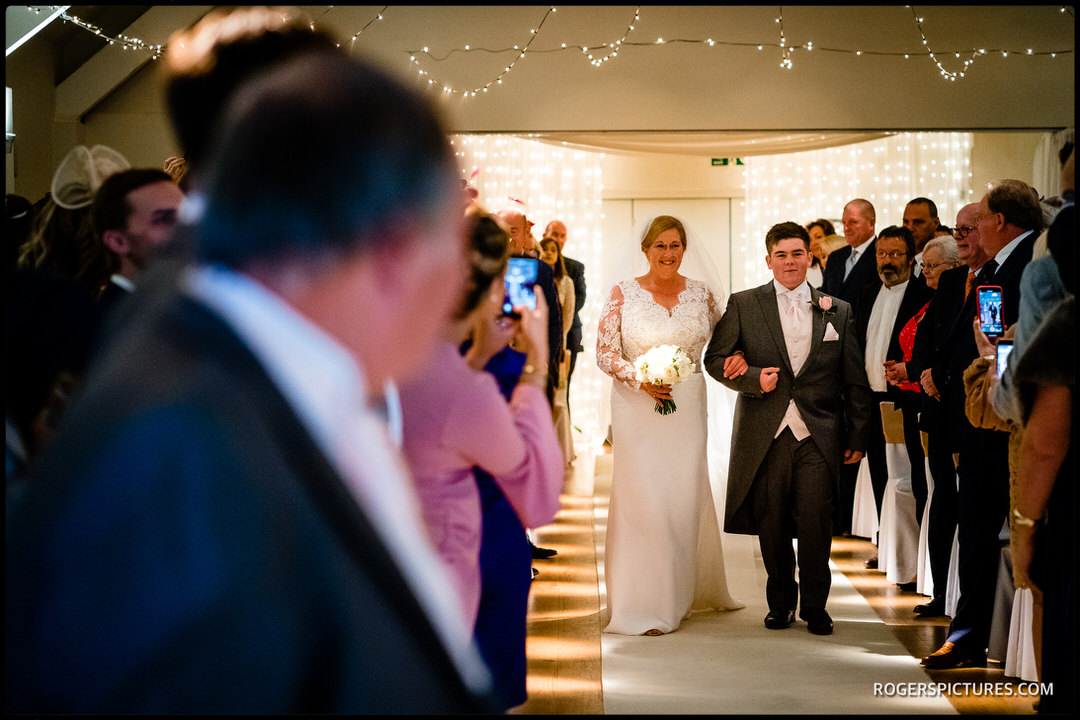 Bride arrives for wedding ceremony at Stoke Place Hotel