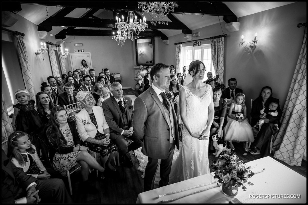 Black and white photo of wedding ceremony at Widbrook Grange