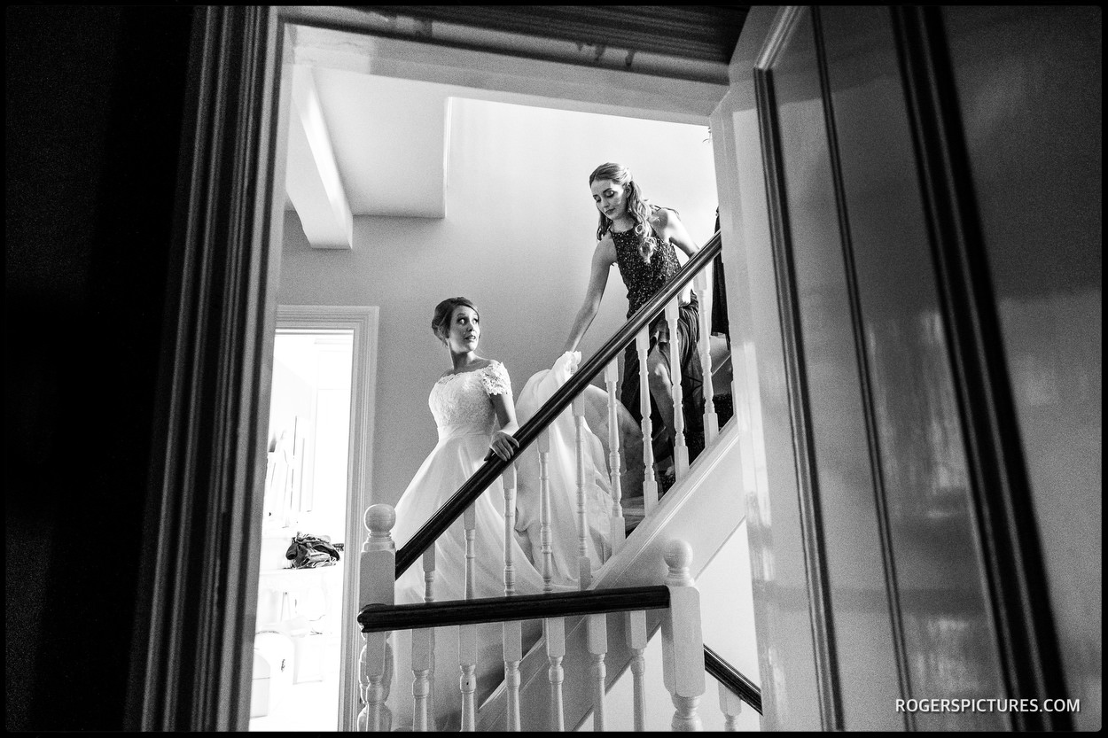 Bride walking down stairs before Hatfield House wedding