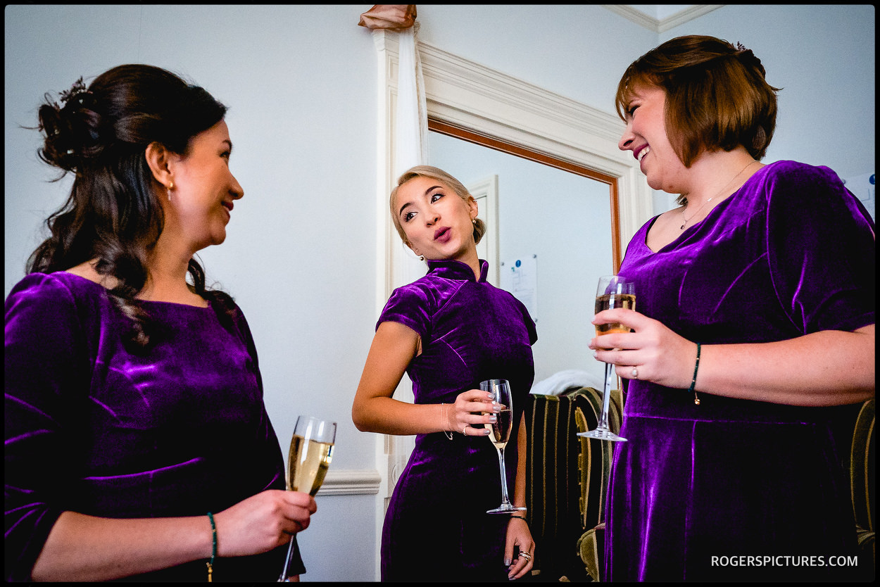 Bridesmaids in purple velvet dresses