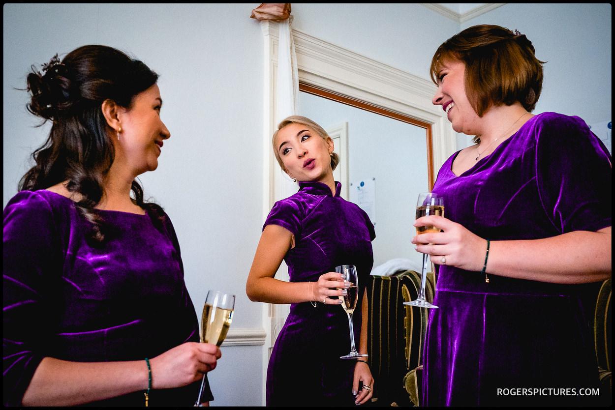 Bridesmaids in purple velvet dresses