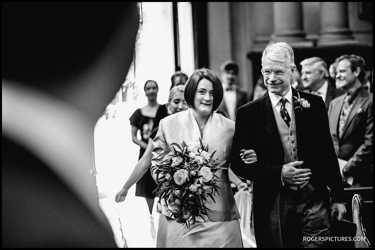 Bride and Father enter St Mary le Strand church wedding