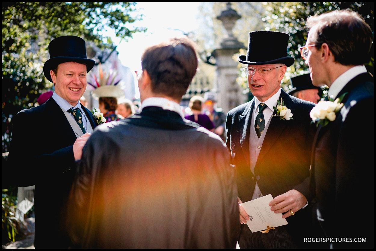 Wedding guests in top hats