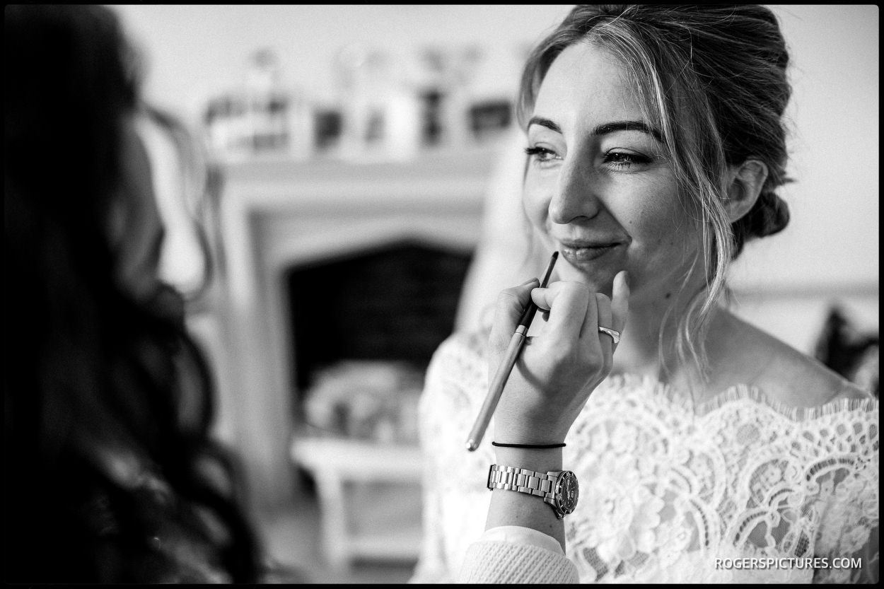 Black and white photo pf Bride getting ready at Nonsuch Mansion