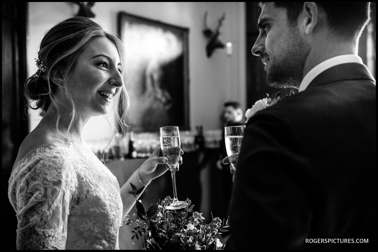 Newly married couple with champagne at Nonsuch Mansion