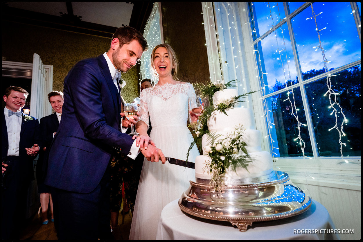 Wedding cake cutting at Nonsuch Mansion