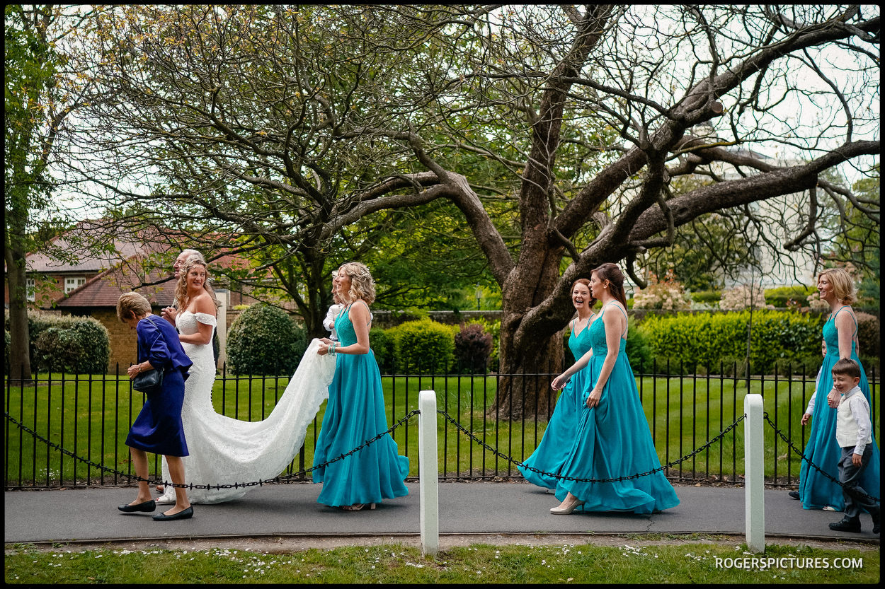 Bridesmaids and bride walk to Dulwich College for the wedding ceremony