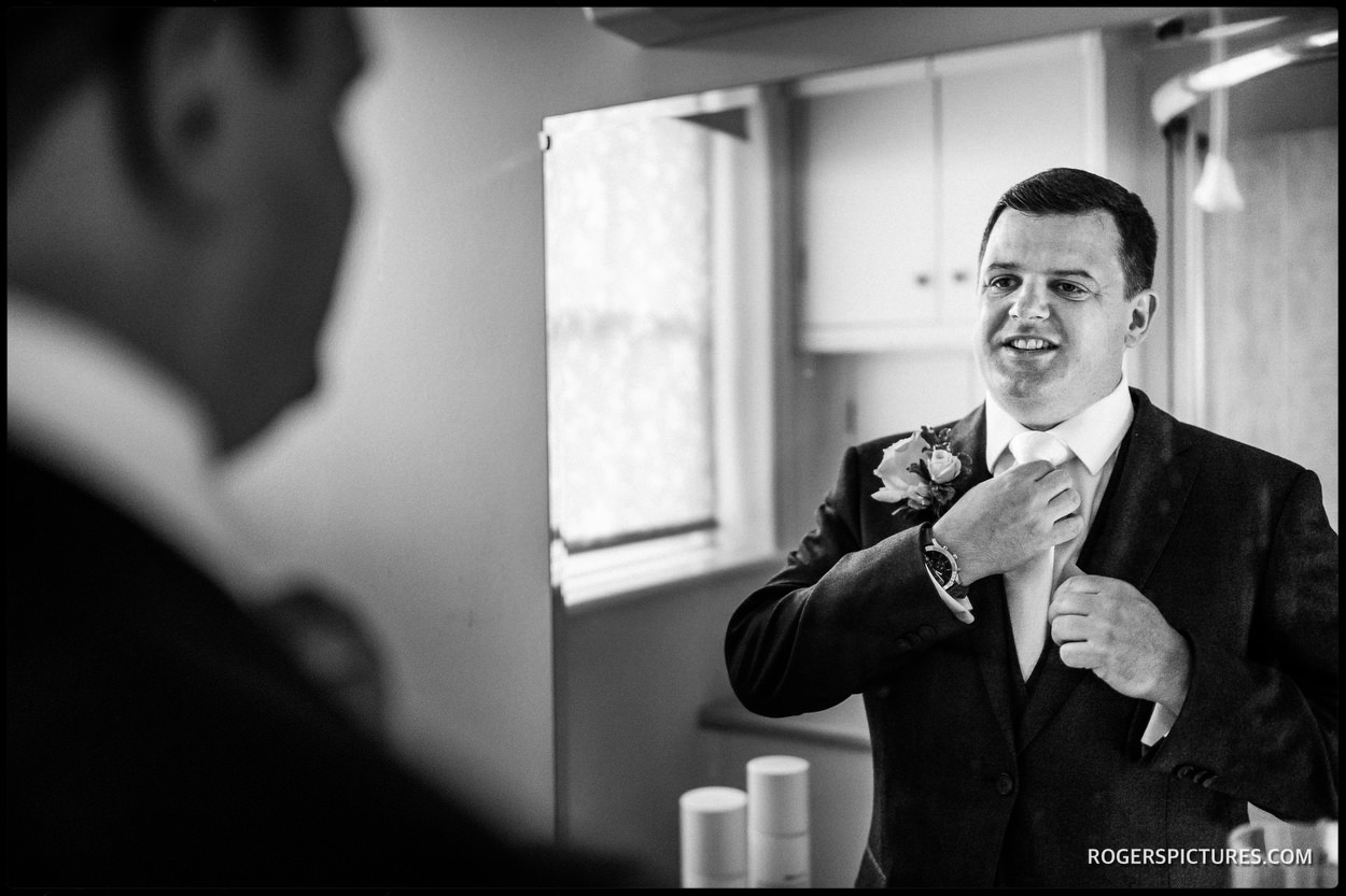 Groomsmen getting ready at Wadhurst Castle Cottage