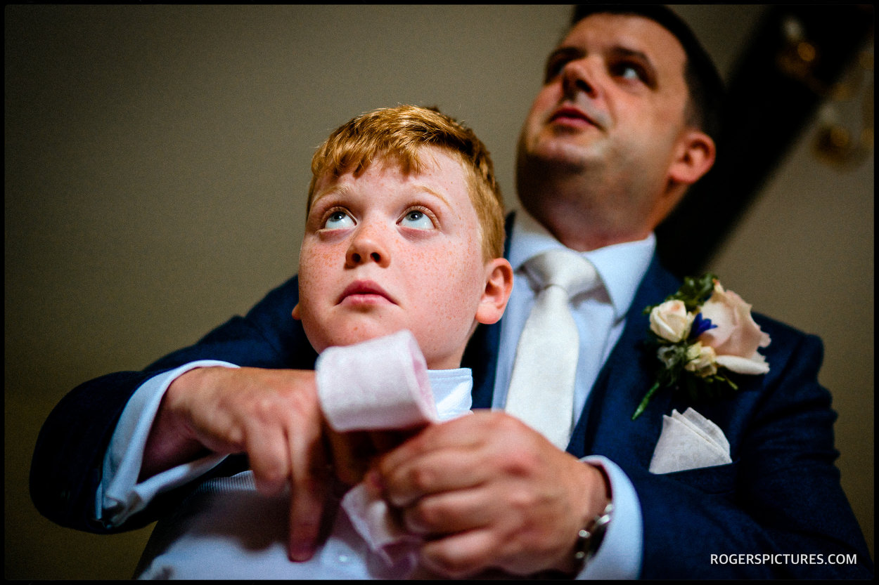 Documentary wedding photo gf groomsmen getting ready at Wadhurst Castle Cottage