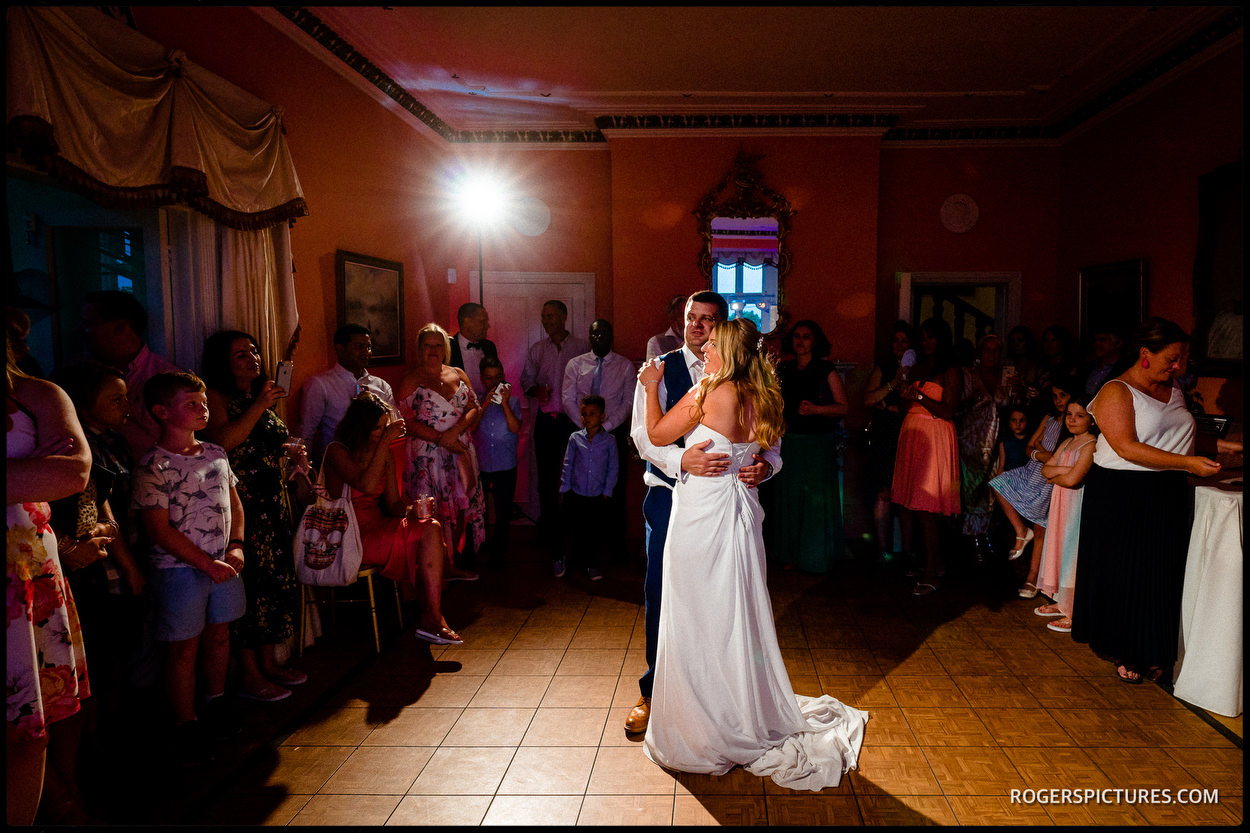 Bride and groom dancing at Wadhurst Castle in Sussex